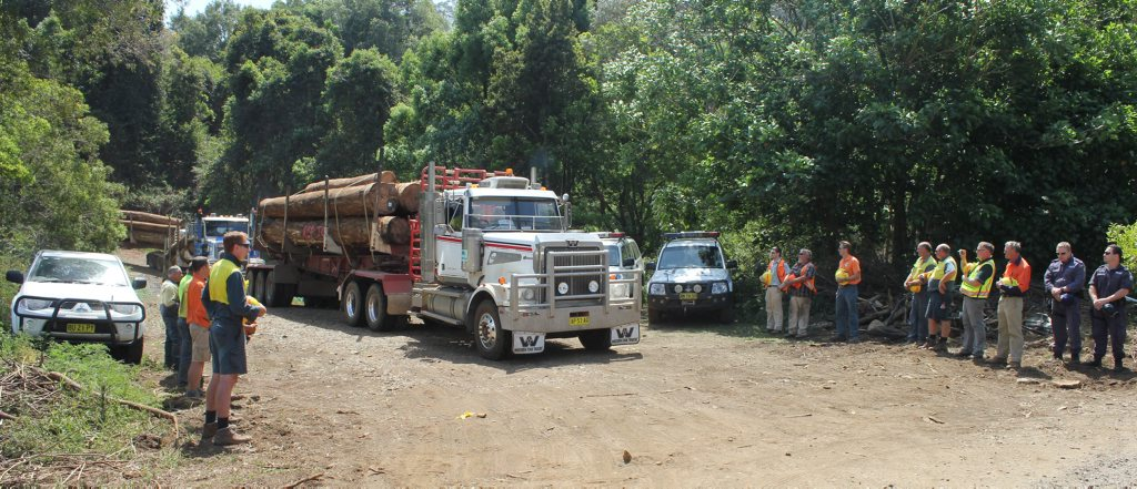 Forestry workers at Whian Whian, form a guard of honour, following the accidental death of their colleague.