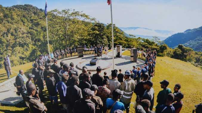 A service for the fallen on the Kokoda Track. Ashley Birt's photo was one of the many hung up around the memorial.