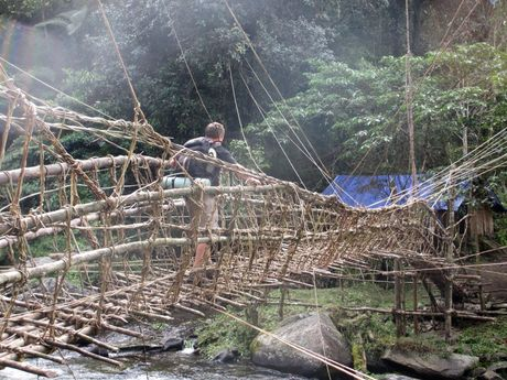 Dale Birt crosses one of the many bridges on the Kokoda Track.
