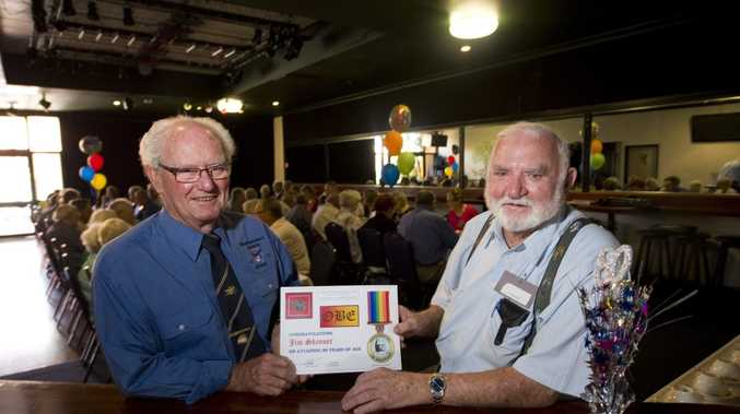 Toowoomba and District Branch of the National Serviceman's Association president Leo Camm (left) with Jim Skinner and one of the certificates presented to the Nashos who turned 80 this year.
