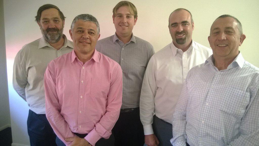 Celebrating the merger are (from left) Trevor Henderson, Louis Tassone, John Henderson, Ian Hurley and Anthony Stevens.