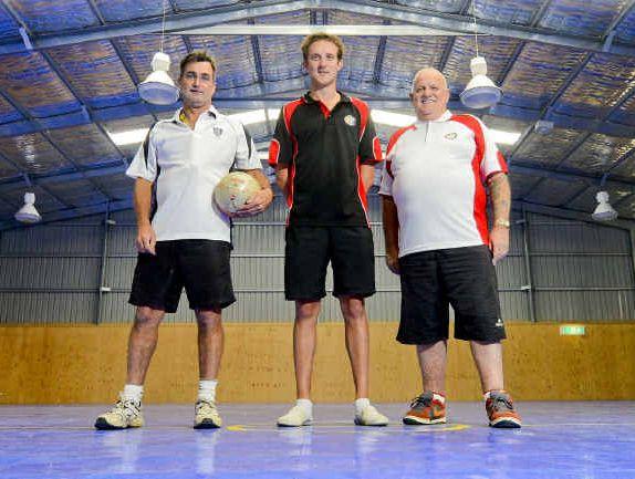 Grafton High teacher Mick Hillary, Australian Futsal Association development officer Damien Parker and AFA education officer Ian Bentall look over the newly laid futsal floor. Photo Adam Hourigan