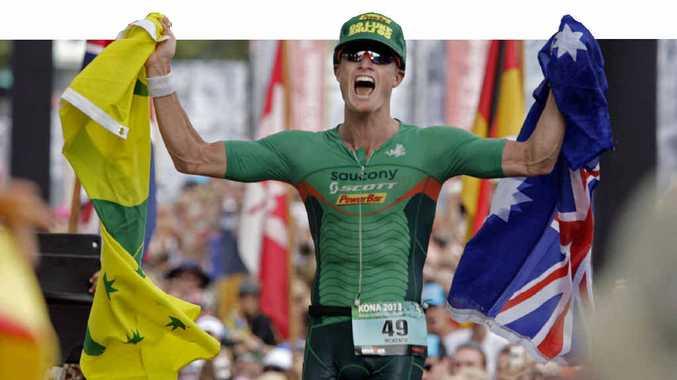 Luke McKenzie, of Sunshine Beach, crosses the finish line to grab second place at the Ironman World Championship Triathlon in Kona on Saturday.