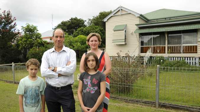 Joffre St residents (from left) Paul Herbert and Clare McConnel, with Paul's children Lawson and Selina Herbert stand in front of the house set for demolition.