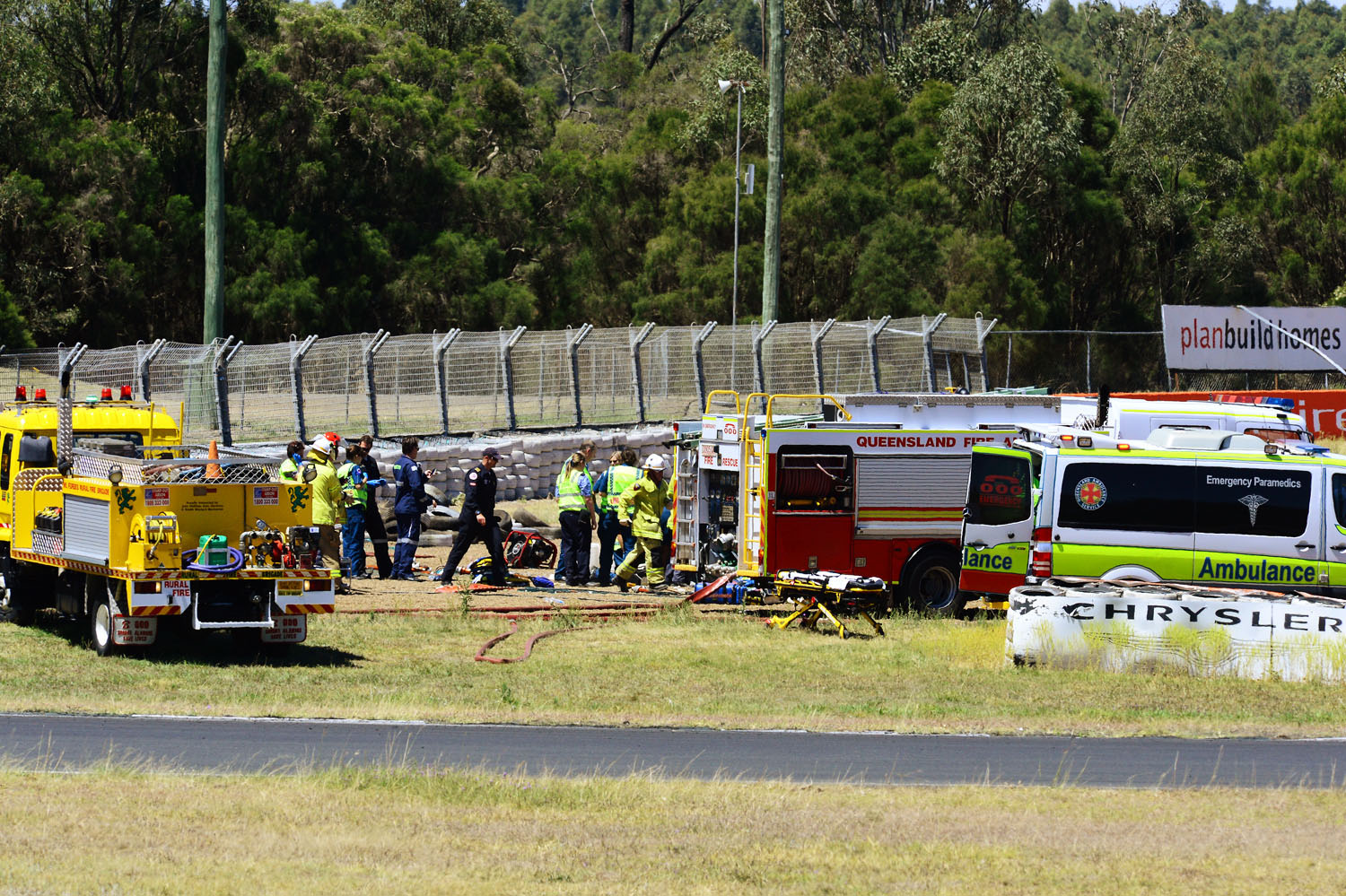 TRACK TRAGEDY: Emergency services workers at the scene of the crash.