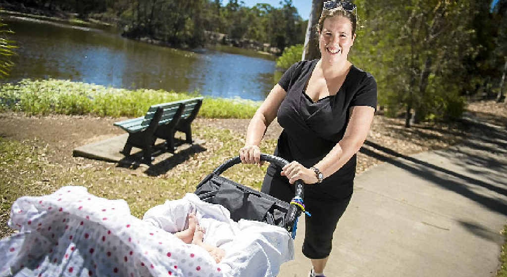 Pamela Syposez and two-month-old Annabelle Olarte out for a walk.