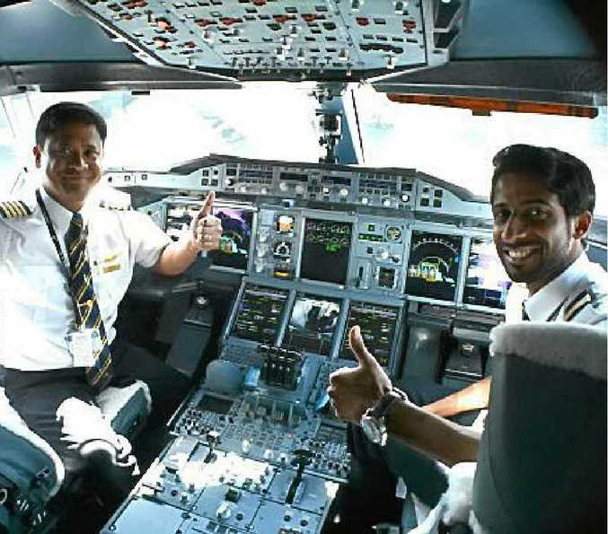 Thumbs up from the pilots and thumbs up for the business class bar onboard the A380.