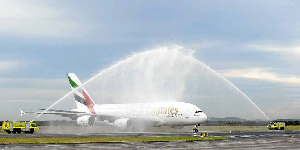 The first Emirates A380 is given a wet welcome on its historic first arrival to Brisbane.
