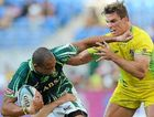 WRAPPED UP: Australian skipper Ed Jenkins tackles South Africa's Cornal Hendricks during the Gold Coast Sevens Cup semi-final at the weekend.