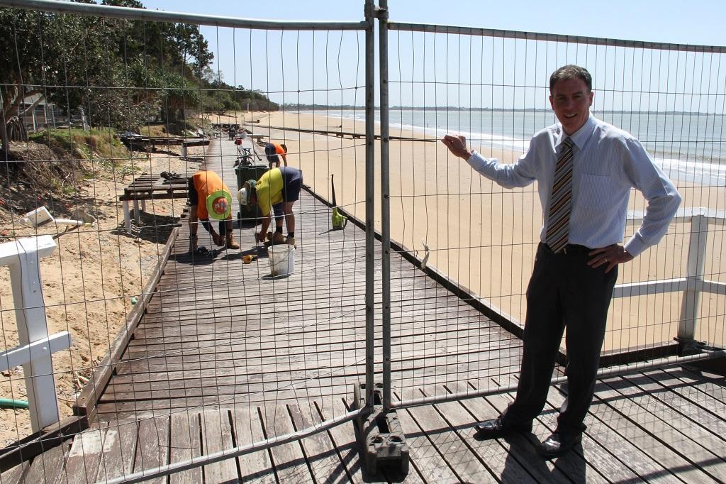 Fraser Coast Mayor Gerard O'Connell checks work on the demolition of the Torquay beach boardwalk.