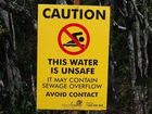 A warning sign near a Maryborough creek that was contaminated with sewerage after a blocked main last week.