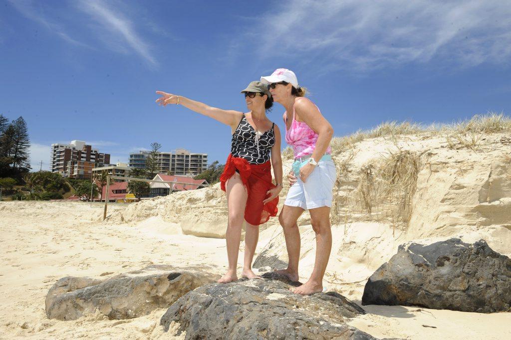 Laure George and Susan Stead standing on Little Groyne at Kirra Beach.