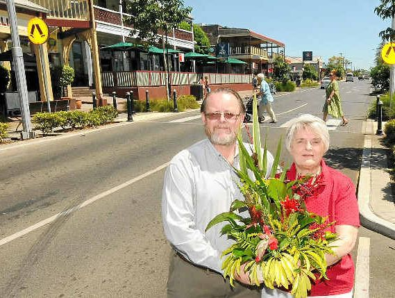 SHOW OF LOVE: Julia Adlington, from St Bartholomew's Anglican Church flower group, and Les Wiles, from the Alstonville Lions Club, prepare for Alstonville Show Week which starts on Saturday, with a market on Sunday in Main St.