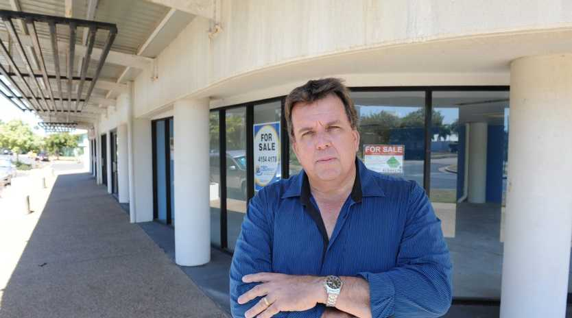 INVESTIGATION: Cr Greg Barnes outside the Platinum Apartments in Bargara where overcrowded units is an issue.