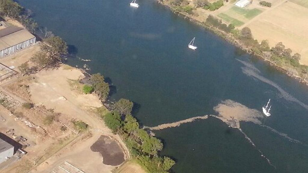 UNAPPEALING: An aerial view of the Burnett River near the East Waste Water Treatment Plant where an unidentified brown substance was visible in the water yesterday morning. Photo Contributed