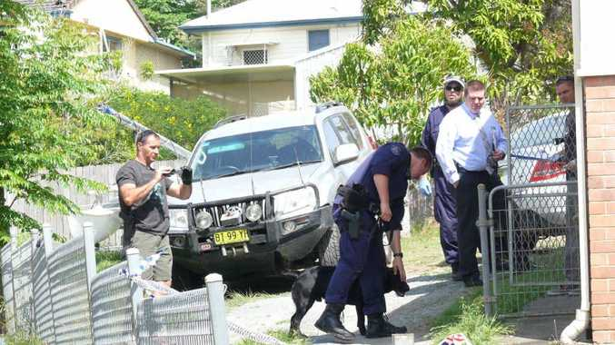 RAID: Police search a Margaret Crescent house on Wednesday.