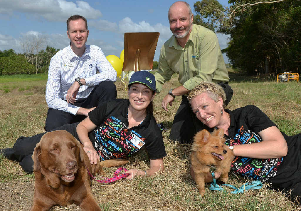 Mackay Regional Council's Craig Shepherd, RSPCA volunteer Marcia Bendall with Java, RSPCA QLD executive manager Michael Hornby and RSPCA volunteer Monique Feder with Olly at the site of what will be Mackay's RSPCA Shelter.