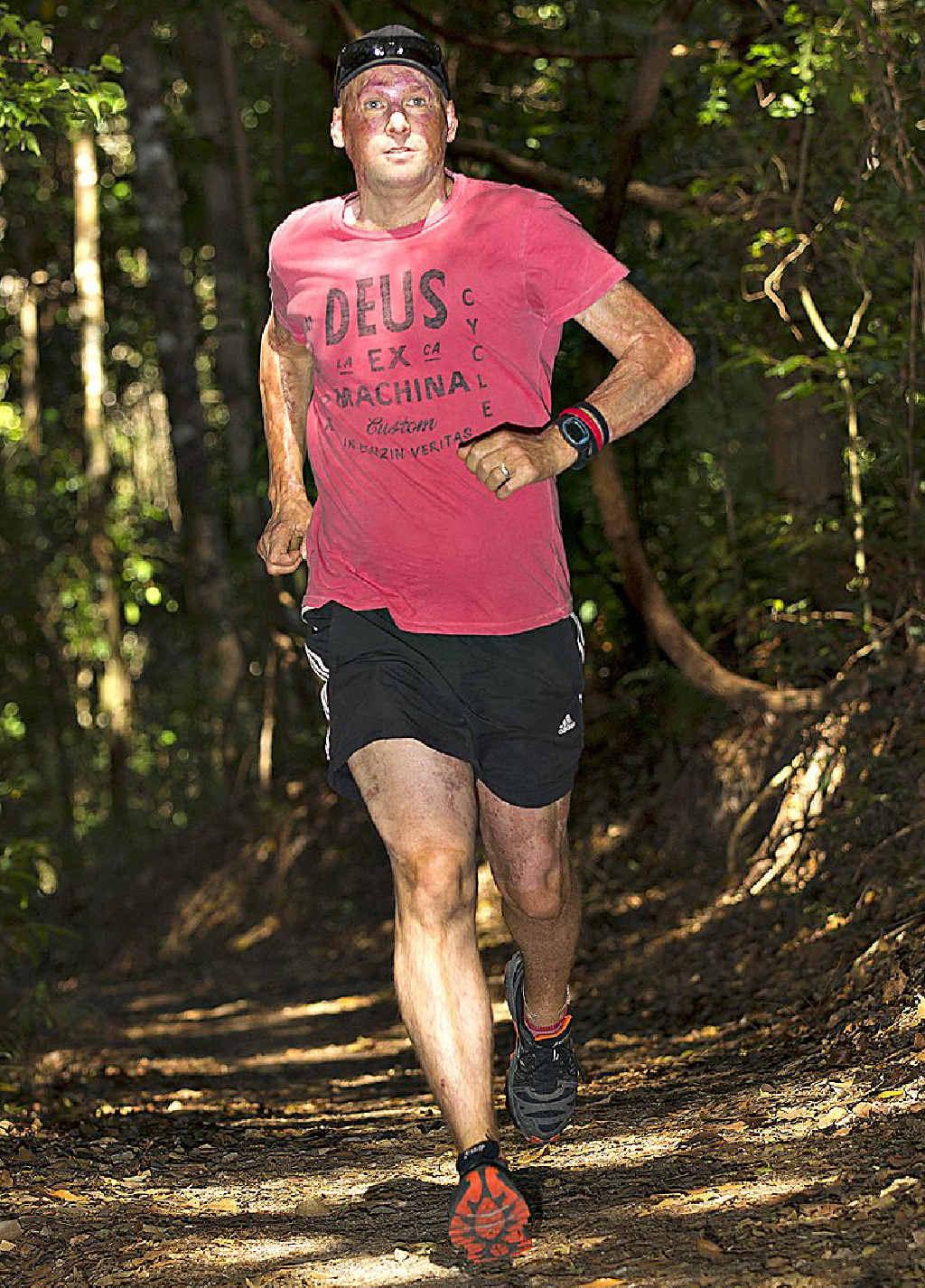 HERE AND NOW: Matt Golinski runs through Noosa National Park.
