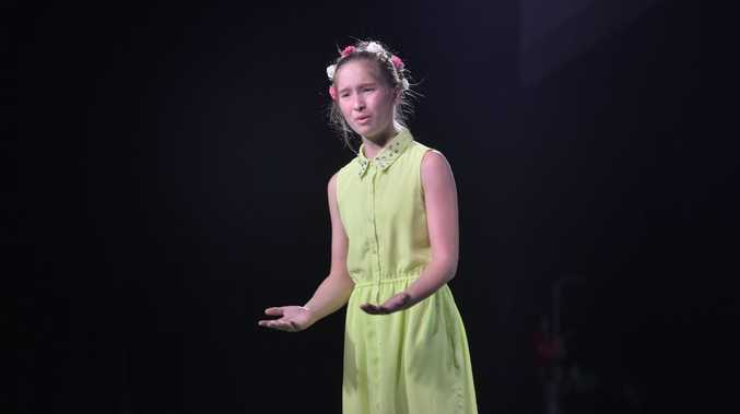 The 43rd Gladstone City Eisteddfod, Bridie Stevens performing in Any Poem by Australian Author, 11 years category, coming in first place.
