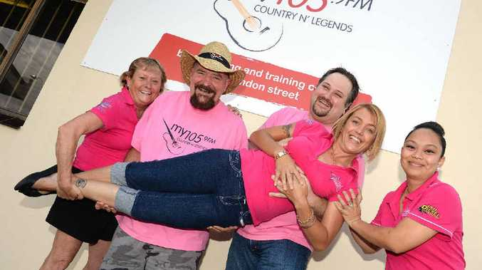 Vicki Vidier, Neil Macca, Daniel Webster and Monica Fletcher lift Raelene Wells in support of Pink Ribbon Charity.