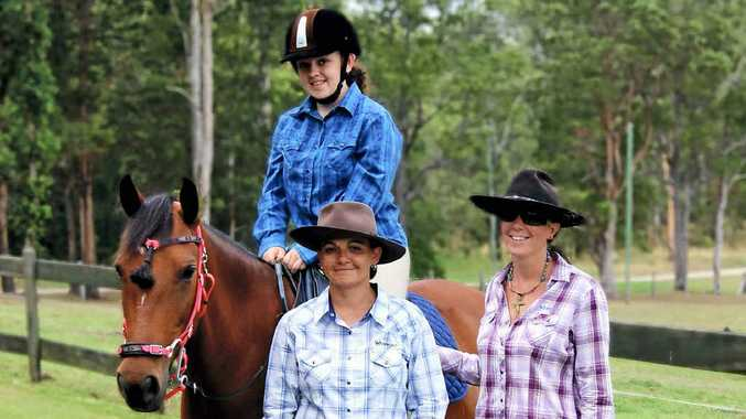 BUILDING RELATIONSHIP: Alyfia Kidman on Brandi with her mother Alanis and horse trainer Miranda Wells.