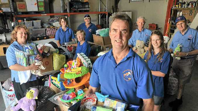 SHARE THE LOVE: Bill Close (front) and staff and volunteers from Care Outreach are hoping to make Christmas special for bush families.