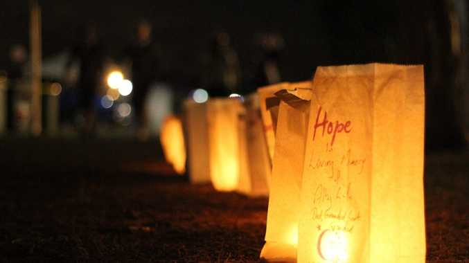 CANDLE CEREMONY: Candles of hope are laid around the walking track at the Bundaberg Showground Relay For Life. Photo: Paul Donaldson / NewsMail