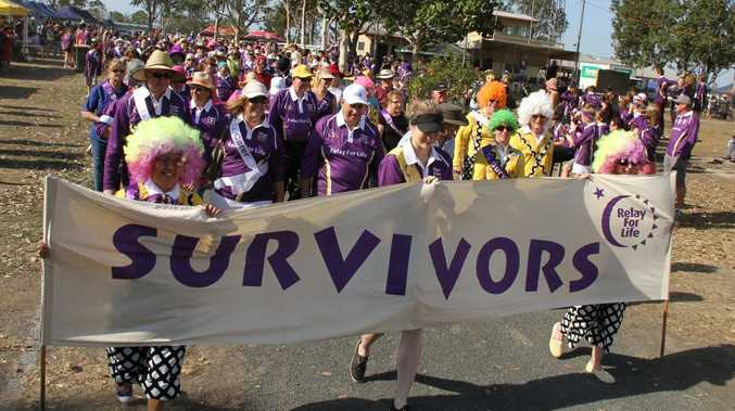 SUVIVORS LAP: A sea of purple takes to the track at the Bundaberg Showground Relay For Life. Photo: Paul Donaldson / NewsMail