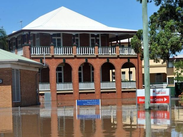 RECORD FLOOD: Bundaberg Hospital is partially evacuated in the face of severe flooding. Photo: Max Fleet / NewsMail