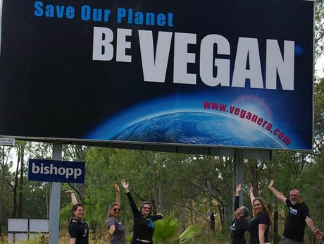 Toowoomba Vegan Era members Elouise Quinlivan, Pauline Metzroth, Alana Roy, Mo Orr, Suzanne Finch, George Orr unveil new billboard at bottom of Toowoomba Range. Contributed