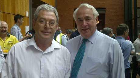 Mayor Paul Antonio congratulates Doug Coates who is retiring after 41 years with Toowoomba Regional Council.
