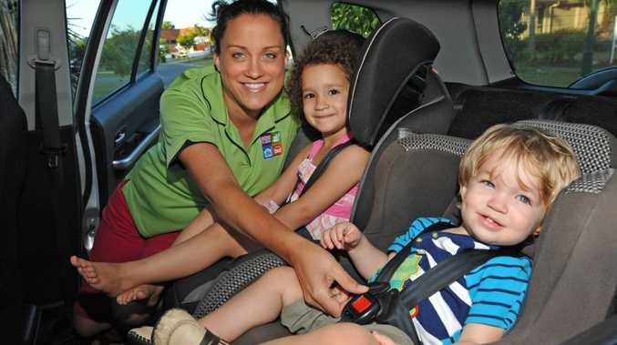 (left) Pamela Rose-Holt from Attention To Detail, a Kidsafe accredited child restraint fitter, buckles up her kids Gemma, 3, and Levi, 16 months, in their car seats. She is urging parents to keep kids bucled up and replace older child seats for safety reasons. Photo: Iain Curry / Sunshine Coast Daily