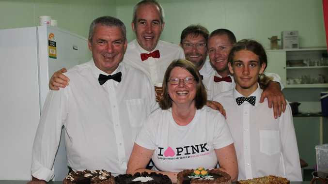 Kristy Bloomfield with the waiters at the 2013 Girls Night In Cancer Council fundraiser.