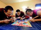 Sand 'comes and goes' as monks make mandala