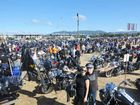 HOG RUN: Nova Cassin with Winchy, representing the Coffs chapter, surrounded by fellow enthusiasts at the Jetty Foreshores at the successful state HOG rally. LEIGH JENSEN