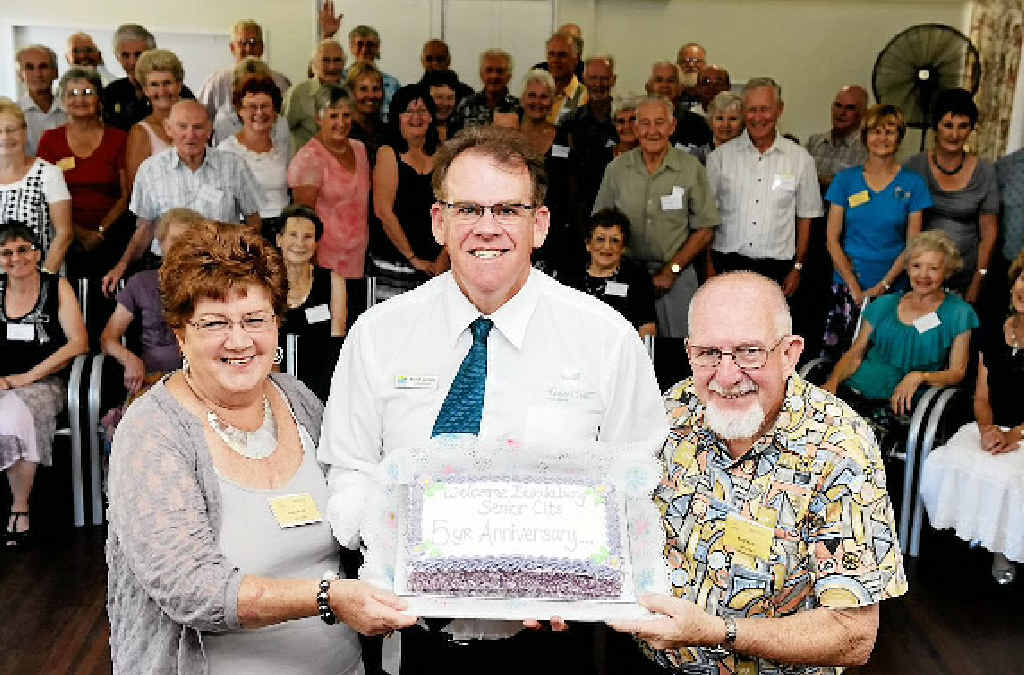 Jackie and Errol Best and the Sixty and Better Social Dance Group celebrating the organisation's fifth anniversary with Fraser Coast councillor Robert Garland.