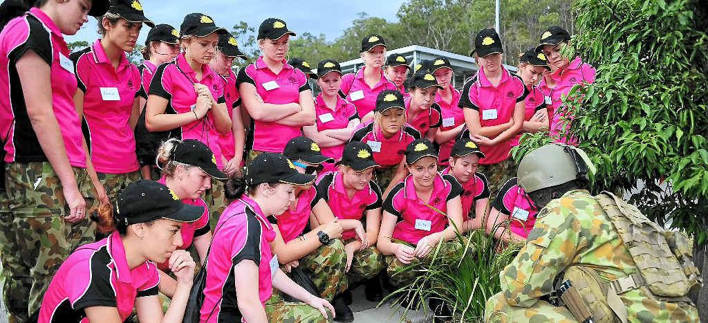 URBAN ASSAULT: Australian Army platoon commander Lieutenant Chris Freeman, 8th/9th Battalion, Royal Australian Regiment, talks tactics to be used during an urban assault with the high school students.