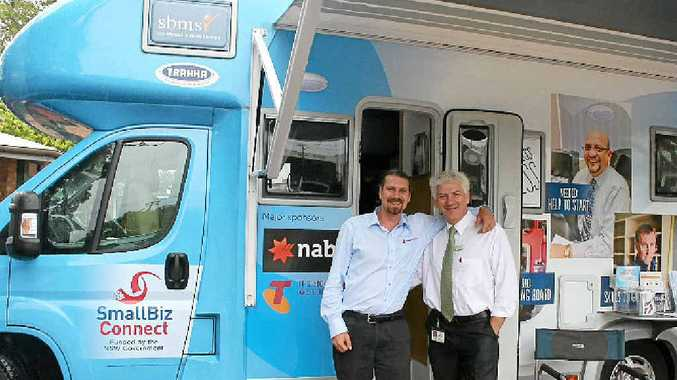 ON A ROLL: Business adviser Ty Peterson with Lismore Council business facilitator Mark Batten at the Small Biz Bus in 2013.