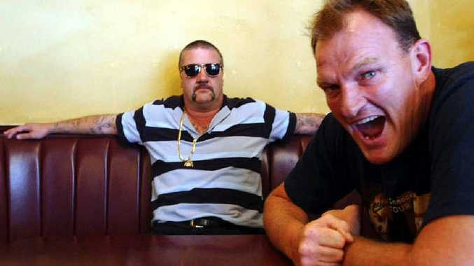 WORD OF MOUTH: Mark 'Chopper' Read and Mark 'Jacko' Jackson in a publicity shot for their comedy tour in 2003. Pictured left is Chopper's former bodyguard Mark 'Hammer' Dixon.