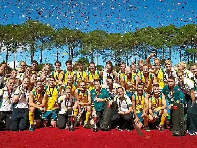 Kirstin Johnson celebrates with the Aussie Hockeyroos and Kookaburras.
