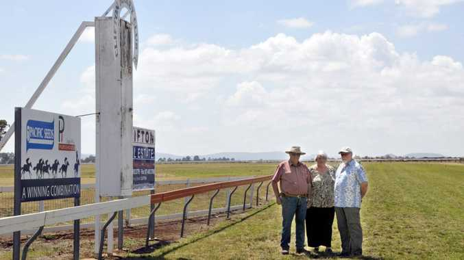 Clifton Jockey Club president George Cross (left), secretary Margaret Cross and Toowoomba Turf Club committee member Peter Oakhill preparing for Saturday's cup-day meeting.