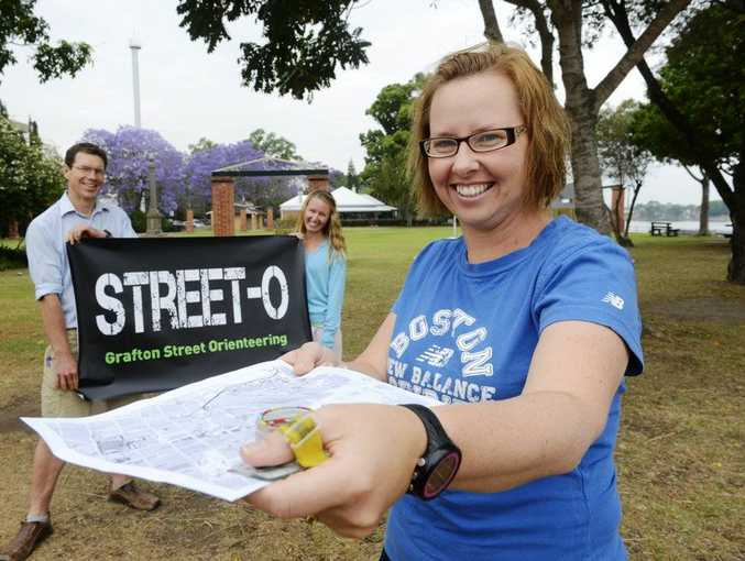 STREET SMARTS: Juile Irvine (fron) with Gvain and Naomi Rayward who are bringing street orienteering to the Clarence Valley. Photo: Adam Hourigan / The Daily Examiner