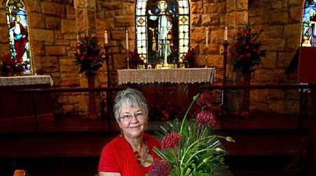 """AT RIGHT: Co-ordinator of the St Bartholomew's Floral Group with """"The Colour of Love"""" floral display at St Bartholomew's Anglican Church."""