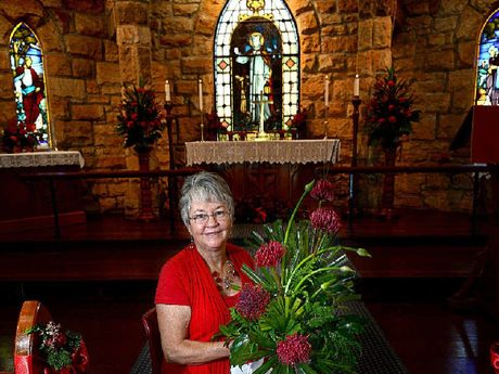 "AT RIGHT: Co-ordinator of the St Bartholomew's Floral Group with ""The Colour of Love"" floral display at St Bartholomew's Anglican Church."