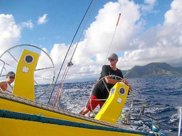 VETERAN racing yachtsmen Ivan Macfadyen pilots his boat, Funnel Web, out of Hawaii. Inset: Byron Bay ocean man Dave Challis.