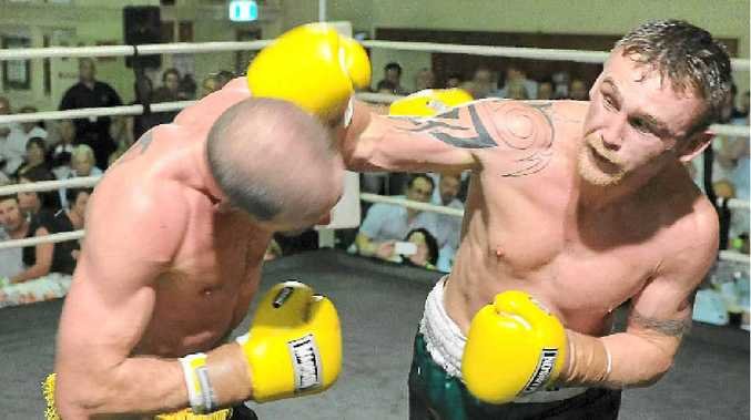 Irishman Dennis Hogan (right) goes on the attack on his way to winning the Boxing Union of Ireland Celtic Nations light middleweight title with a unanimous points decision over Gavin Prunty at the Irish Club in Brisbane last month.