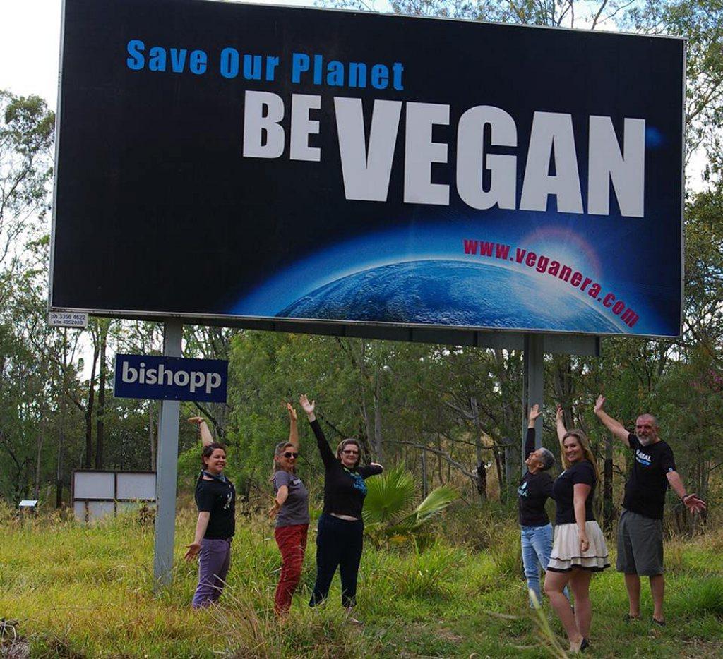 Toowoomba Vegan Era members Elouise Quinlivan, Pauline Metzroth, Alana Roy, Mo Orr, Suzanne Finch, George Orr unveil new billboard at bottom of Toowoomba Range. Contributed