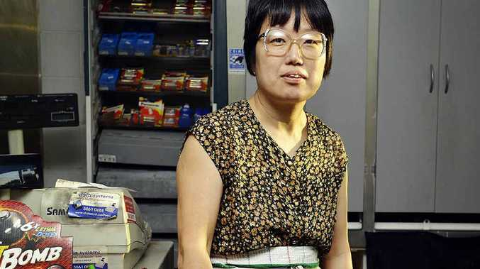 BRAVE: Liu Bing Xin defended herself against a masked armed robber with a can of bug spray.