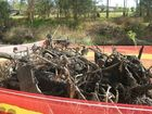 SPRING CLEAN: Ipswich City Council removed piles of shopping trolleys, tyres and other debris from Bundamba Creek on Wednesday.