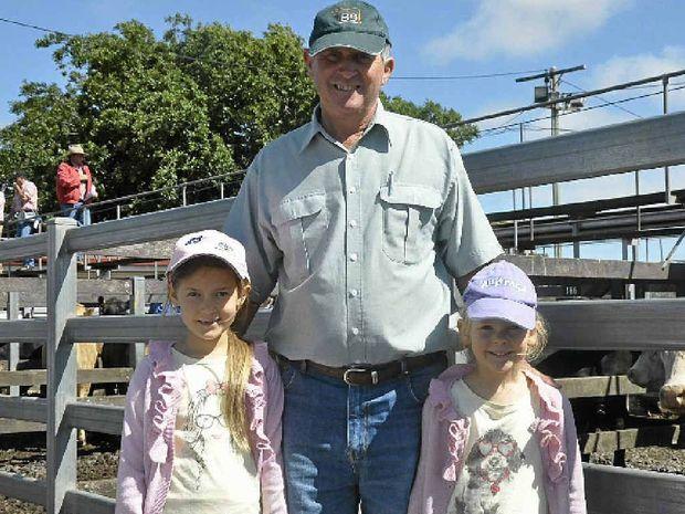 SALEYARD SNAPSHOT:  Denis Janetzki (centre) of Jondaryan with his granddaughters Elizabeth Janetzki (left) and Charlotte Janetzki (right) at the Elders sales in Toowoomba on Monday.